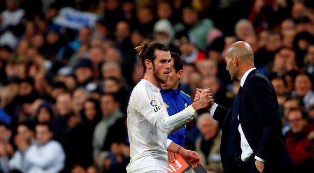 Real Madrid's new coach Zinedine Zidane greets Real Madrid's Gareth Bale as he leaves the pitch on Saturday