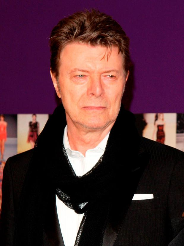 FILE - In this June 7, 2010 file photo, David Bowie attends the 2010 CFDA Fashion Awards in New York. Bowie, the innovative and iconic singer whose illustrious career lasted five decades, died Monday, Jan. 11, 2015, after battling cancer for 18 months. He was 69