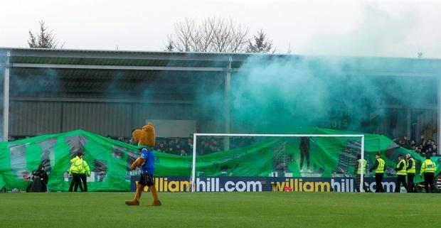 Flares set off in the stands before kick off during the Scottish Cup, Fourth Round match at Stair Park, Stranraer.
