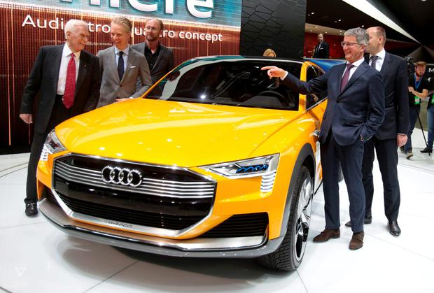 Rupert Stadler, Chairman of the Board, Audi AG (R), points to Capt. Gene Cernan, the last man to walk on the Moon (L), as he introduces the Audi h-tron Quattro concept car at the North American International Auto Show in Detroit, Michigan January 11, 2016. REUTERS/Rebecca Cook