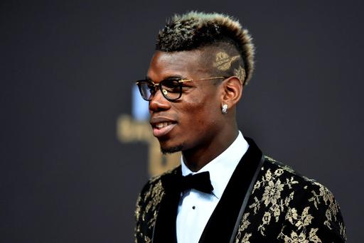 France and Juventus midfielder Paul Pogba poses on the red carpet