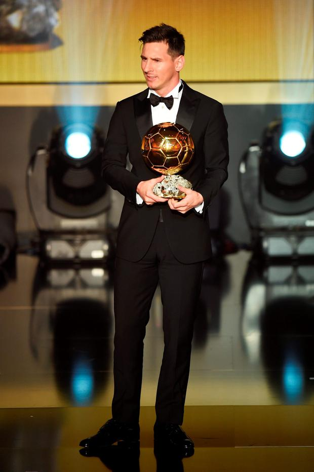 Lionel Messi receives the Ballon d'or during the FIFA Ballon d'Or Gala 2015