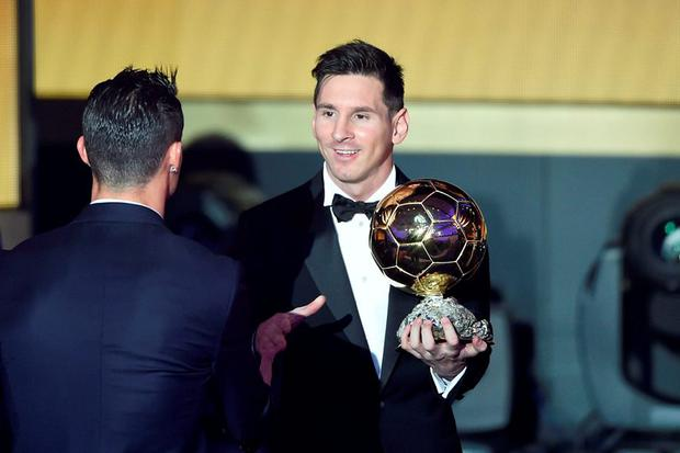 Lionel Messi speaks with Cristiano Ronaldo after winning