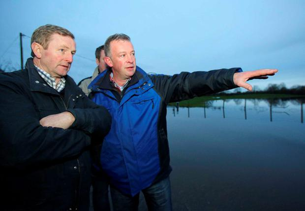 Taoiseach Enda Kenny visiting Justin Flannery's beef farm in Peterswell, East Galway that has remained under water and has been badly impacted by floods. Picture: Hany Marzouk.
