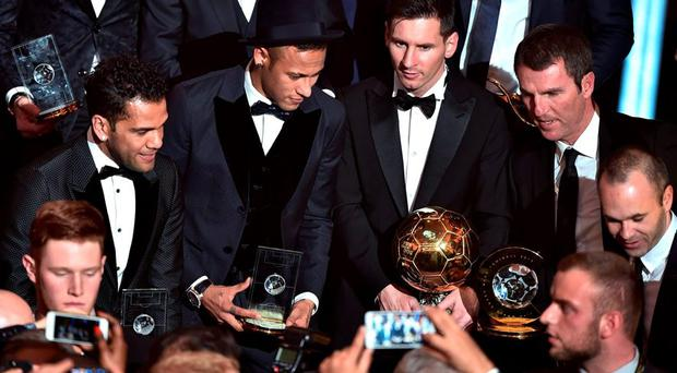 Dani Alves, Brazil, Neymar, Lionel Messi, Barcelona technical director Robert Fernandez and Spain and Andres Iniesta pose at the end of the 2015 FIFA Ballon d'Or award ceremony