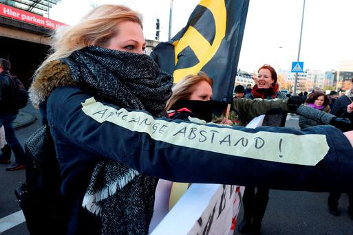 AA German protester with a sticker reading 'an arm's-length distance', referring to the mayor of Cologne's suggestion on how to prevent being assaulted by men. Photo: AFP/Getty