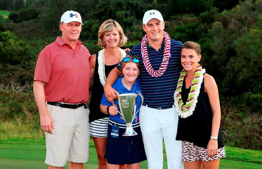 Jordan Spieth poses with parents, Shawn and Chris, sister Ellie and girlfriend Annie Verret after his victory in the Hyundai Tournament of Champions Photo: Getty Images