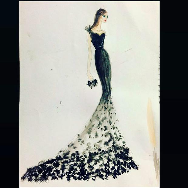 Design involved a train with over 800 black silk organza petals mixed with lace and tulle which all had to be hand sewn onto the skirt