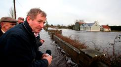 The Taoiseach said he wants insurers to address 'the contradiction' between their claims that they are insuring homes where flood defences are put in place, and the stories he is hearing from people on the ground. Brian Lawless/PA Wire