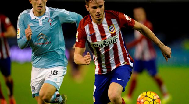 Atletico Madrid's midfielder Saul Niguez (right)