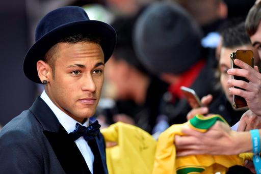 Neymar poses on the red carpet as he arrives for the 2015 FIFA Ballon d'Or award ceremony at the Kongresshaus in Zurich yesterday
