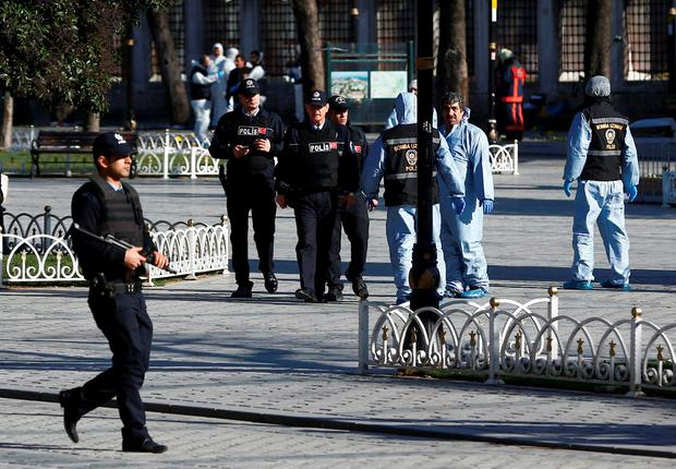 Police secure the area after an explosion near the Ottoman-era Sultanahmet mosque in Istanbul, Turkey.