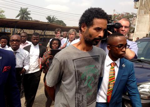 Arthur Simpson-Kent (2nd R), who is wanted over the murder of a former EastEnders actress and her two children, leaves a district court after a remand hearing in Accra, Ghana. Reuters/Matthew Bigg