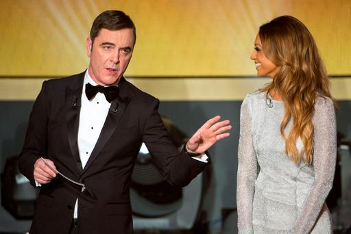 Presenter Kate Abdo and presenter James Nesbitt speak during the FIFA Ballon d'Or Gala 2015 at the Kongresshaus on January 11, 2016 in Zurich, Switzerland. (Photo by Philipp Schmidli/Getty Images)