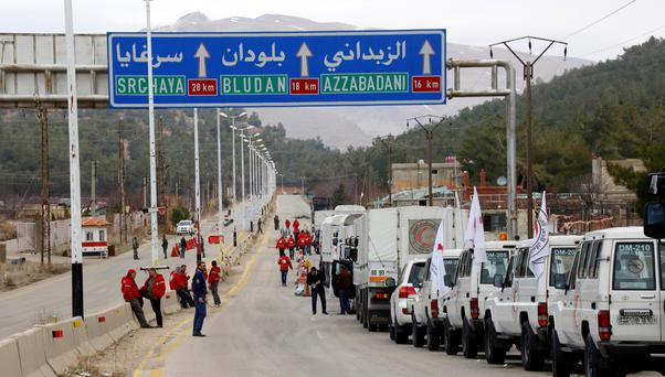A convoy of vehicles loaded with food and other supplies organized by The International Committee of the Red Cross, working alongside the Syrian Arab Red Crescent and the United Nations makes its way to the besieged town of Madaya, about 15 miles (24 kilometers) northwest of Damascus, Syria. (AP Photo)