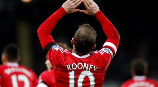 Wayne Rooney celebrates after scoring from the penalty spot