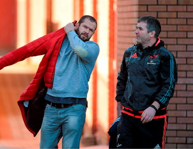 Munster coach Anthony Foley walks out to yesterday's training session with new temporary consultant Andy Farrell. Photo: Diarmuid Greene / Sportsfile