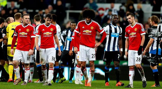 Manchester United's (left to right) Wayne Rooney, Matteo Darmian, Marouane Fellaini and Morgan Schneiderlin look dejected after the Barclays Premier League match at St James' Park