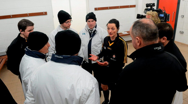 Referee Maggie Farrelly gives some final instructions to her team of officials before last week's Fermanagh v St Mary's University game in the Dr McKenna Cup (SPORTSFILE)