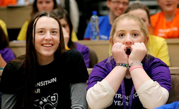 Ailbhe Kenny (16) and Iseult Larkin (16) from Mount Anville Seconday School, Dublin, watch a live Caesarean section at the RCSI. Photo: Maxwells