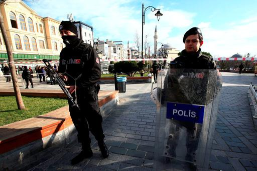 Police officers secure an area at the historic Sultanahmet district, which is popular with tourists, after the suicide bombing in Istanbul. AP Photo/Lefteris Pitarakis