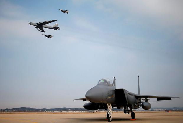 A U.S. Air Force B-52 flies over Osan Air Base in Pyeongtaek, South Korea, January 10, 2016