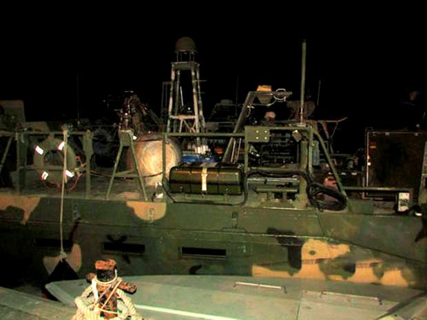 This picture released by the Iranian Revolutionary Guards on Wednesday, Jan. 13, 2016, shows American Navy boats in custody of the guards in an undisclosed location in Iran. Iranian state television is reporting that all 10 U.S. sailors detained by Iran after entering its territorial waters have been released