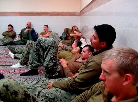 This picture released by the Iranian Revolutionary Guards on Wednesday, Jan. 13, 2016, shows detained American Navy sailors in an undisclosed location in Iran. Iranian state television is reporting that all 10 U.S. sailors detained by Iran after entering its territorial waters have been released