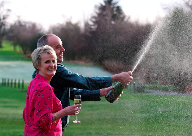 David and Carol Martin, a husband and wife from Hawick in the Scottish Borders, celebrate at the Dalmahoy Hotel & Country Club in Edinburgh after winning half of the historic £66 million Lotto jackpot