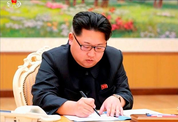 North Korean leader Kim Jong Un signs a document regarding the test of a hydrogen bomb, in this file still image taken from KRT video and released by Yonhap on January 6, 2016