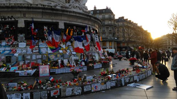 The place de la republique has become a touching monument to the victims, and as the sun goes down passers-by relight the thousands of candles that have been left by previous visitors Photo: Shane Fitzsimons