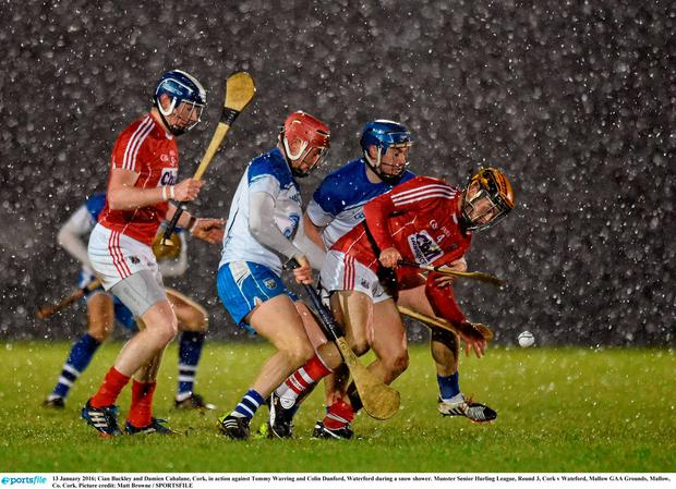 Cian Buckley and Damien Cahalane, Cork, in action against Tommy Warring and Colin Dunford, Waterford during a snow shower. Munster Senior Hurling League, Round 3, Cork v Wateford, Mallow GAA Grounds, Mallow, Co. Cork. Picture credit: Matt Browne / SPORTSFILE