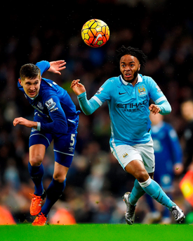 Raheem Sterling of Manchester City and Everton's John Stones tussle for possession at the Etihad Stadium (Photo by Laurence Griffiths/Getty Images)