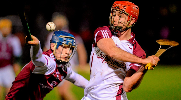 Galway's Paul Hoban in action against Bobby Duggan, NUIG. Picture credit: Seb Daly / Sportsfile