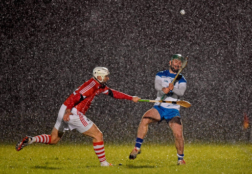 Shane Bennett, Waterford battles Patrick Cronin, for possession in the rain. Picture credit: Matt Browne / Sportsfile