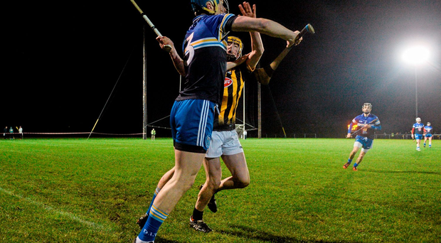 Tommy Doyle of DIT in action against Kilkenny's Billy Ryan. Photo: Sportsfile