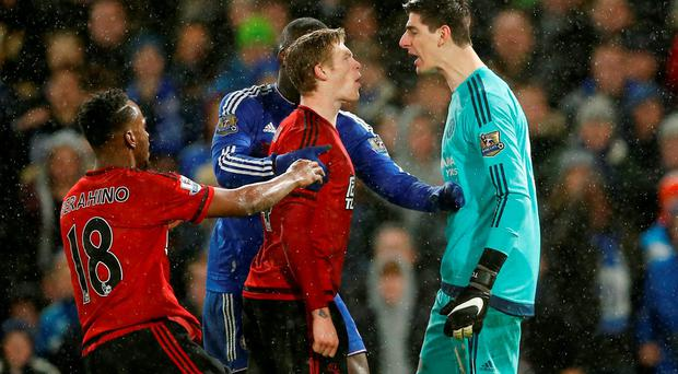 West Brom's James McClean clashes with Chelsea's Thibaut Courtois at Stamford Bridge last night: Action Images via Reuters / John Sibley