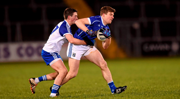 Thomas Corr of Cavan tries to get away from Monaghan's Shane Corey in their Dr McKenna Cup clash last night. Picture credit: Stephen McCarthy / Sportsfile