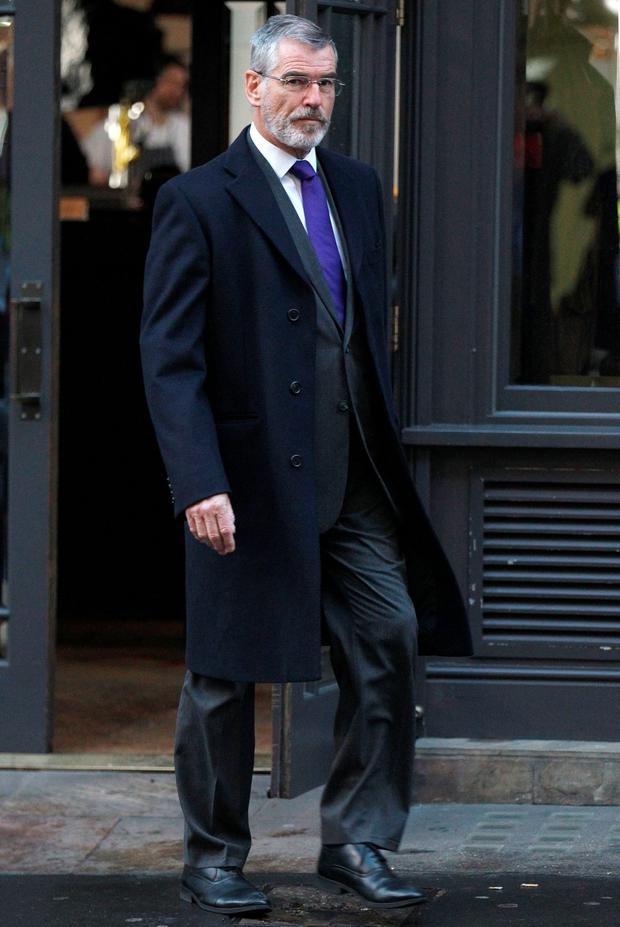 Pierce Brosnan on the set of fliming an upcoming action thriller in London on Thursday. Photo: Rex