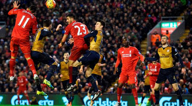 Liverpool's German midfielder Emre Can (3L) jumps for a header with Arsenal's French defender Laurent Koscielny (4L)