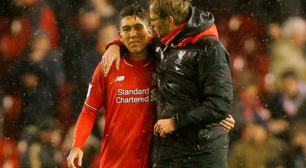 Liverpool manager Jurgen Klopp celebrates with Roberto Firmino