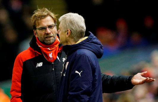 Liverpool manager Juergen Klopp speaks with Arsenal manager Arsene Wenger