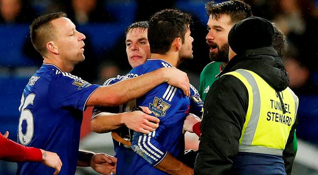 Chelsea's Diego Costa clashes with West Brom's Boaz Myhill at the end of the game