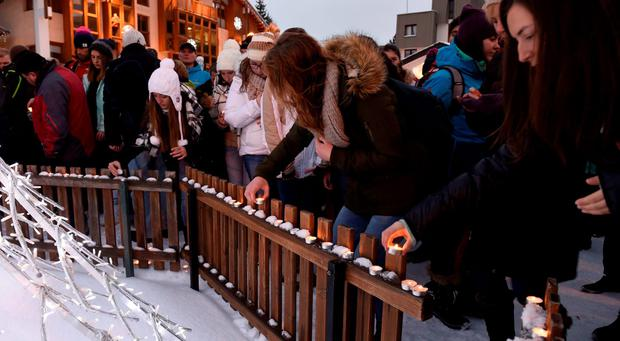 People lay candles in tribute to the victims of the avalanche, on January 14, 2016 at Les Deux Alpes resort in the French Alps, a day after an avalanche swept away skiers, including a group on a school outing, were swept away. Getty Images