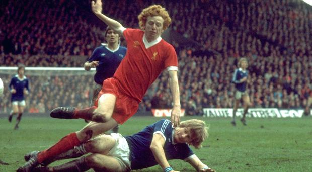 Liverpool 'supersub' David Fairclough is tackled against Everton in 1977. Photo: Tony Duffy/Allsport