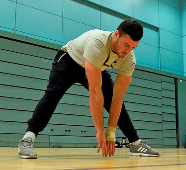 Robbie Henshaw goes through his stretching routine during Connacht's training session at the Kingfisher Club Sport Centre, Galway this week (SPORTSFILE)