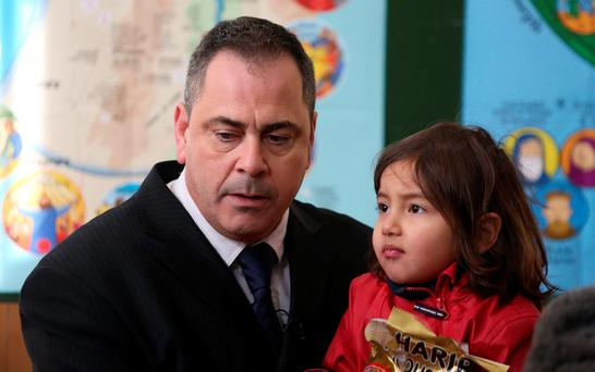 Rob Lawrie appears with Afghan girl Bahar Ahmadi (4) – known as Bru – in Boulogne, France. Photo: PA