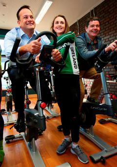Health Minister Leo Varadkar (left), cyclist Ciara Doogan and Sports Minister Paschal Donohoe at the launch of the plan in Ballybough fitness centre in Dublin yesterday. Photo: PA