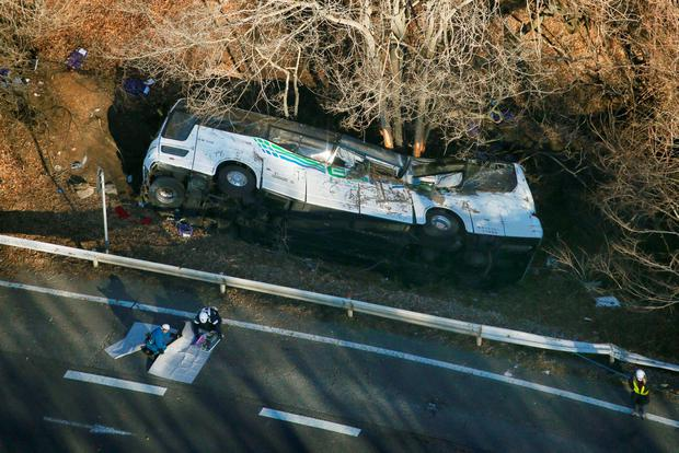 A tour bus that veered off a road is seen after it crashed in Karuizawa, Nagano prefecture, Japan, in this photo taken by Kyodo January 15, 2016. A bus carrying participants in a ski tour crashed Friday morning in Japan's Nagano Prefecture, killing 14 people and injuring another 27