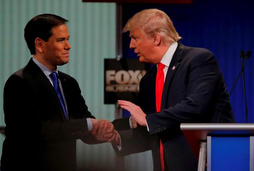 Republican U.S. presidential candidate Senator Marco Rubio (L) shakes hands with rival candidate businessman Donald Trump at the conclusion of the Fox Business Network Republican presidential candidates debate in North Charleston, South Carolina, January 14, 2016